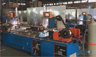 Automatic welding machine for beams